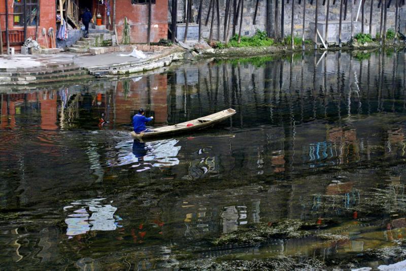 Paddling up the river. Fenghuang, Hunan Province, China