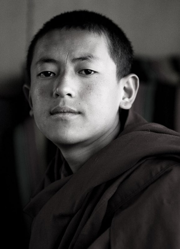 A young monk in a mountain monastery above Lhasa, Tibet.