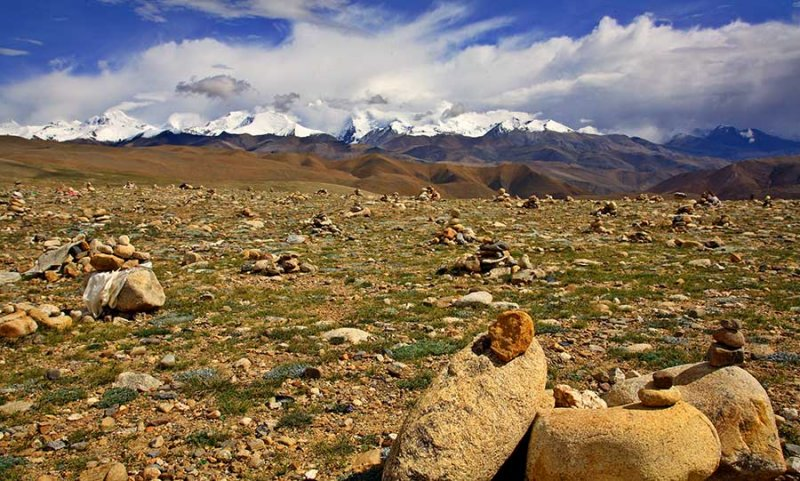 Rocks stacked for prayers as a high pass approaching Nepal from Tibet while taking an overland route.