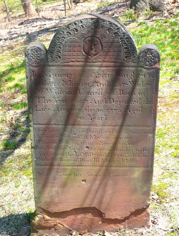 ornate headstone, dating back to the 1700s