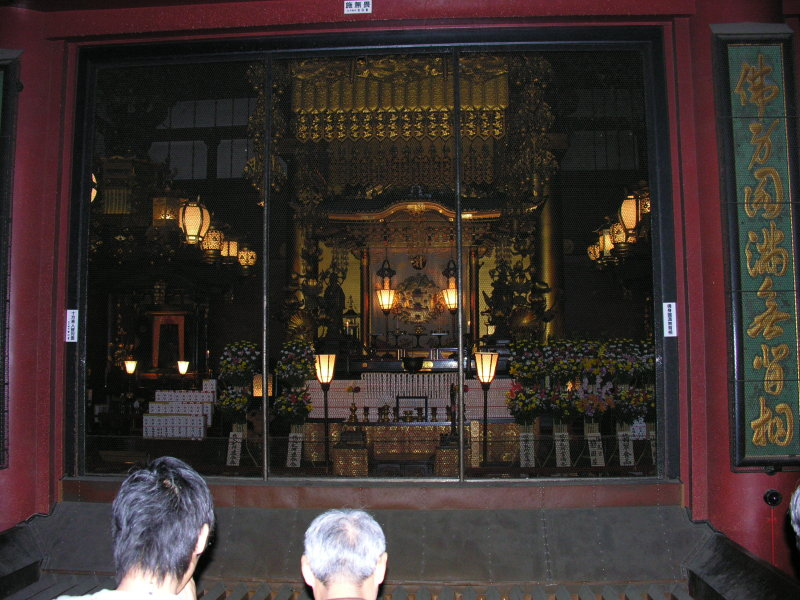 The shrine inside this more ornate temple, not as ancient as others wed seen down south.