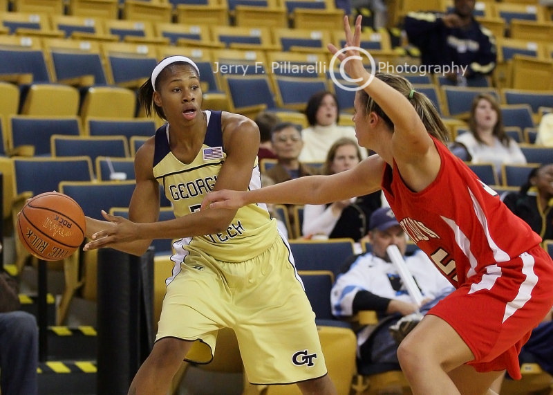 Tech F Montgomery looks for a passing lane around a Wildcats defender