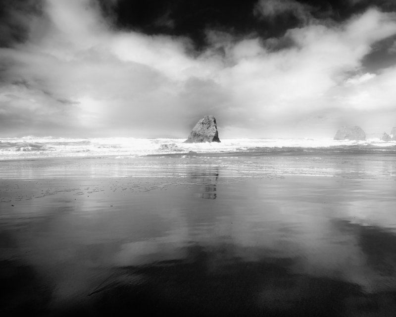 Sea Stack with Clouds and Reflection - Northern California