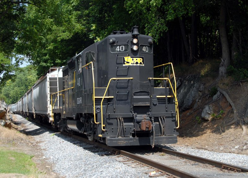 A GP9 leads a string of grain cars into Staunton Va. on the SVRR