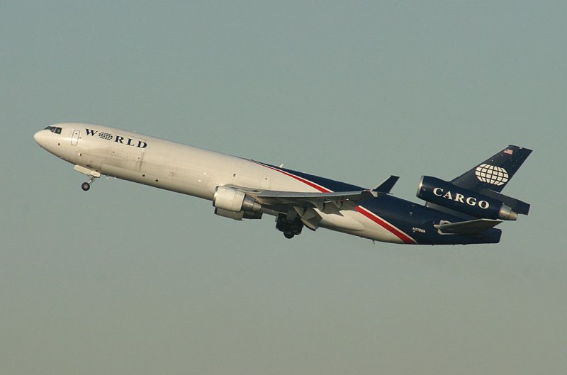 The MD-11 in World Airways new livery departing JFK 22R, Nov, 2007