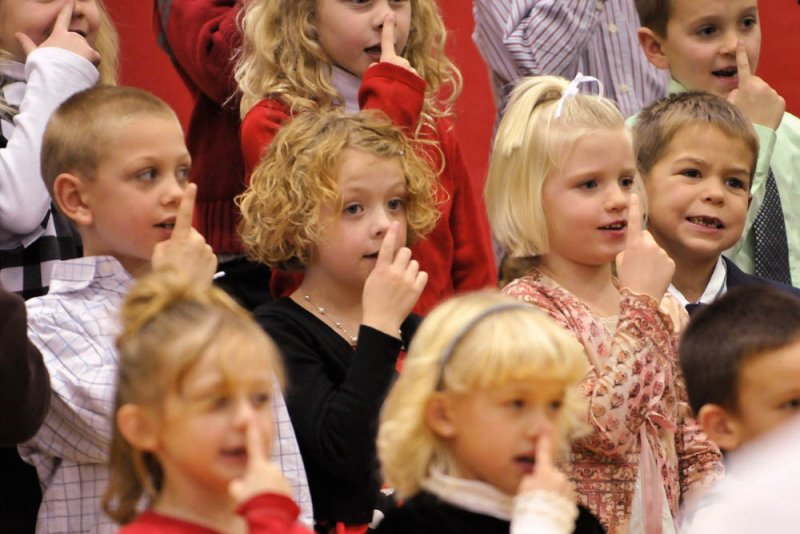 1st graders sing about Rudolphs Nose