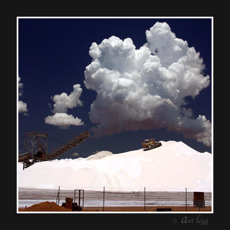 Bulldozer on salt stockpile
