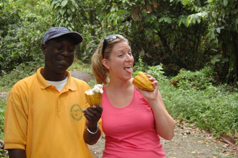 Tour guide Tony and Aimee tasting a cocoa pod