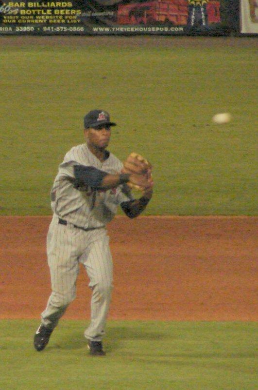 Deibinson Romero throws to first