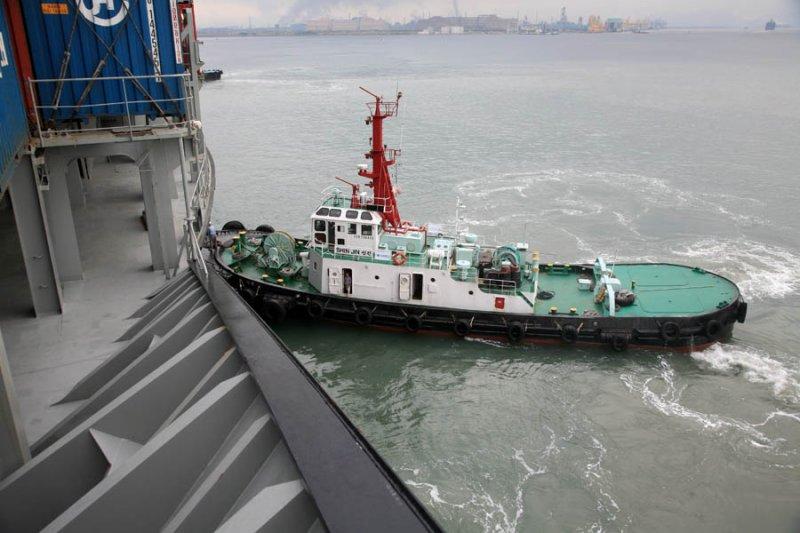 Tug Pushing Vessel In