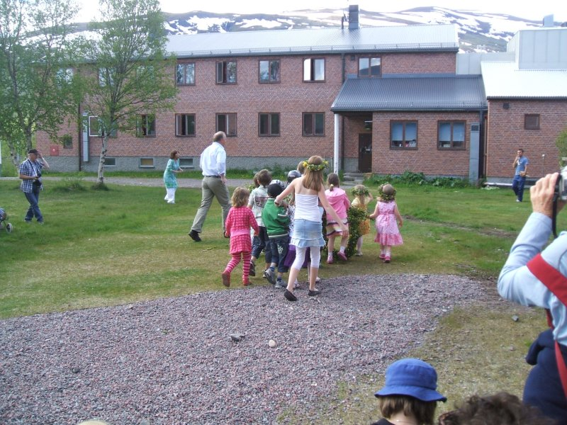 Children carrying the tree which we danced around
