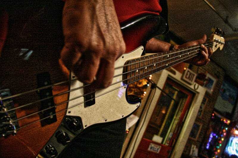 PLAYING THE BASS GUITAR