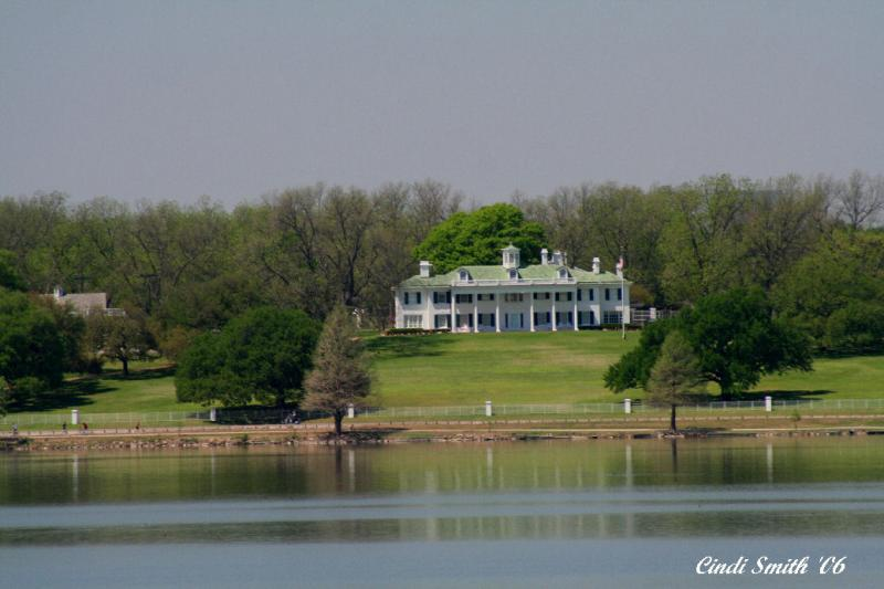 A VIEW OF HL HUNTS HOUSE, MOUNT VERNON, FROM ACROSS THE LAKE