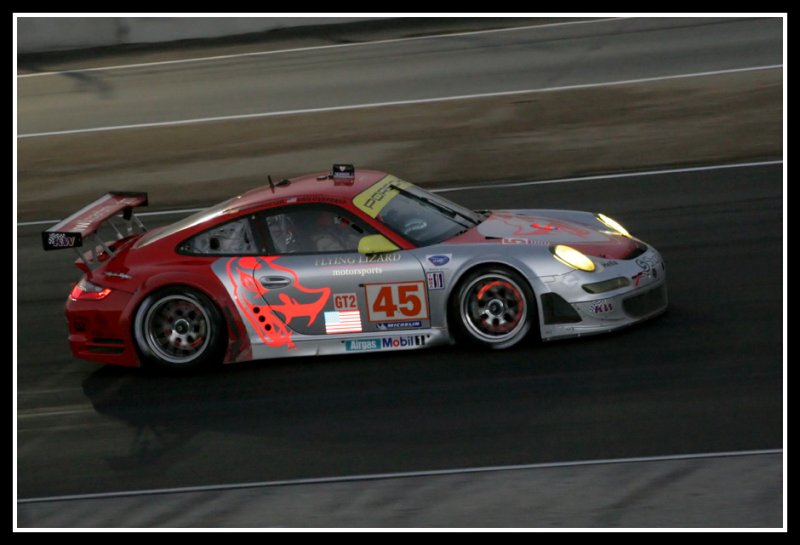 Flying Lizard Motorsports Team at night with glowing rotors
