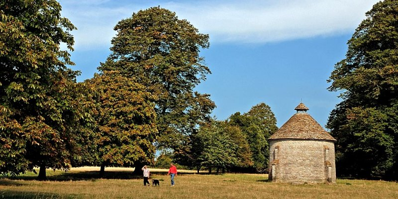 Walkers by the dovecote, Lytes Cary Manor