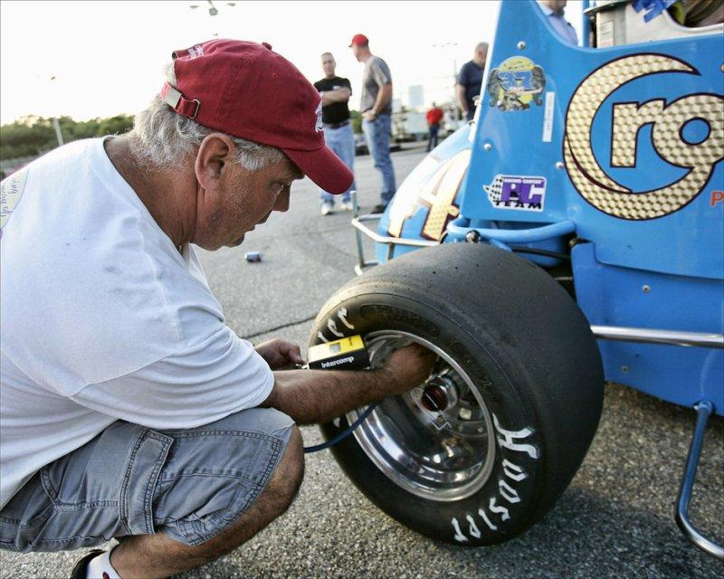 Bob Santos checks tire pressure