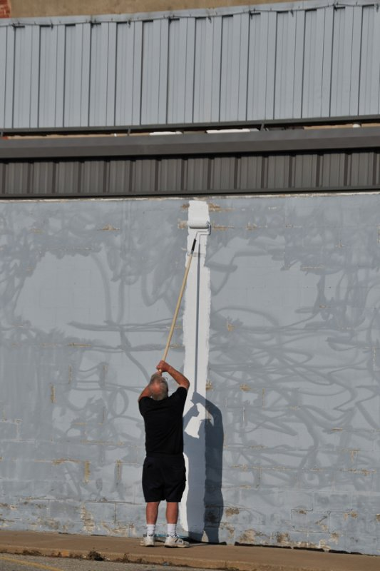 Randy rolling the very first paint on the wall