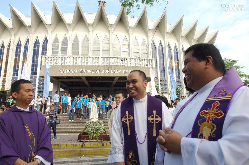 Mons. Bart, Fr. John Paul and Fr. Sonny at the church façade