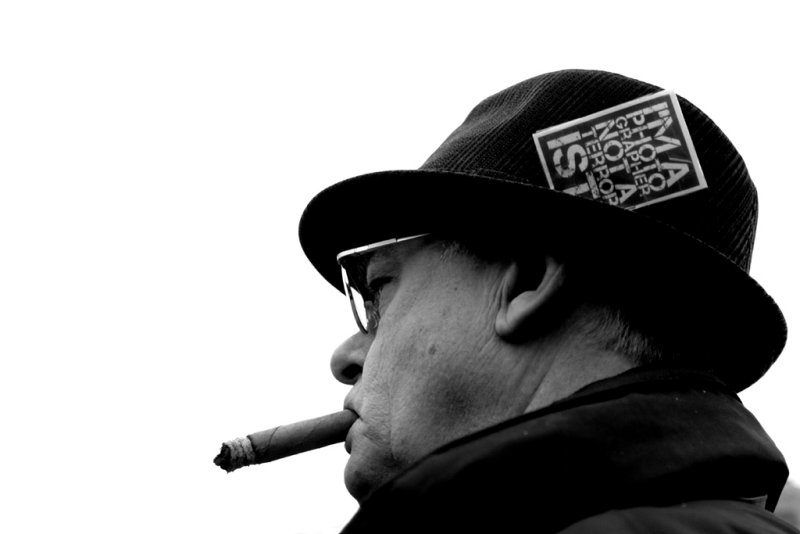 man with cigar: hes a photographer