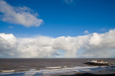 Cromer pier and approaching storm