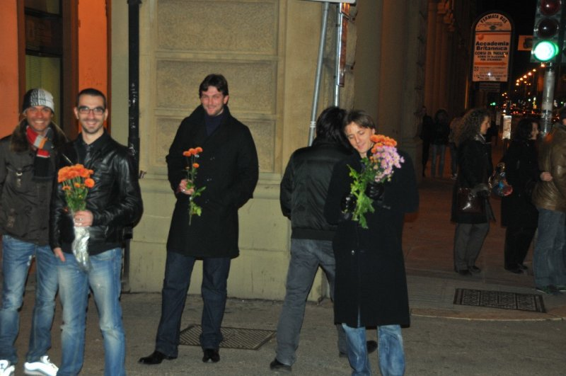 Friends waiting with funeral flowers....
