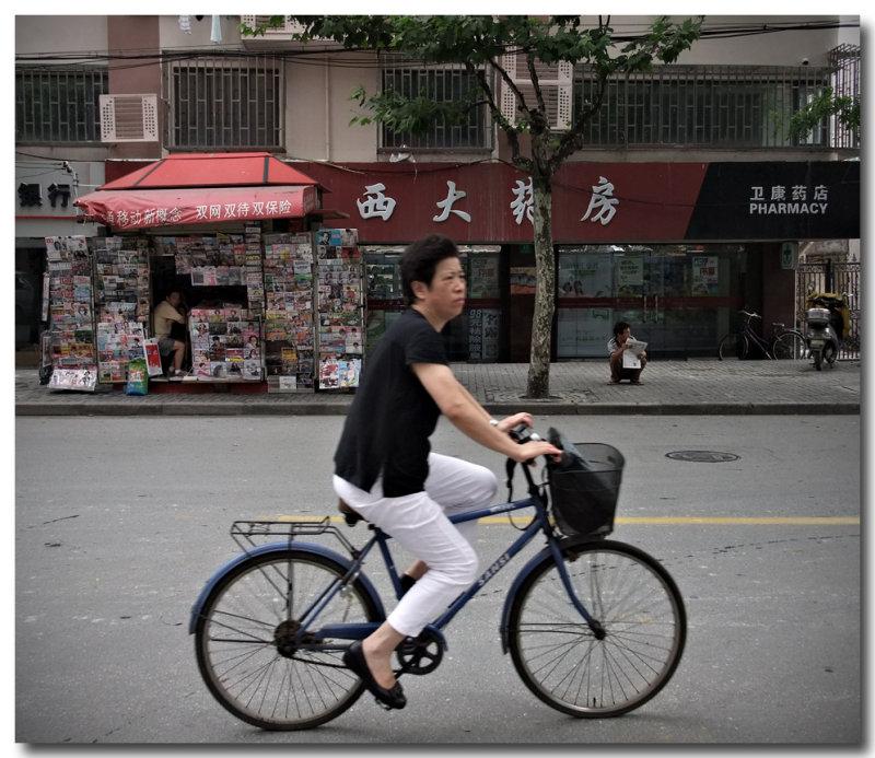 newstand, cyclist & pharmacy