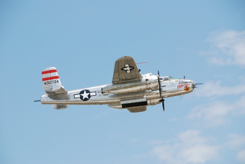 Fla .Airshow - WWII--  B-25 makes a bombing pass over the field.
