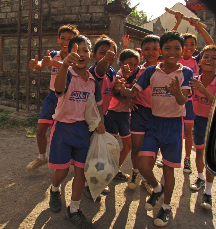 School Kids Carrying their Soccer Balls