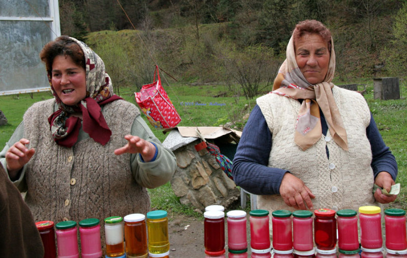 Two Vendors Selling Syrup