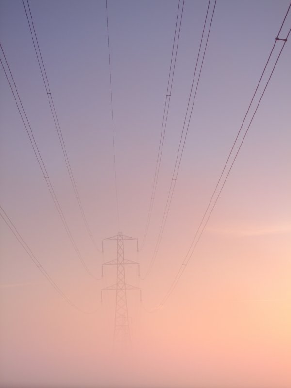 Electricity  pylon  through  the  morning  mist.