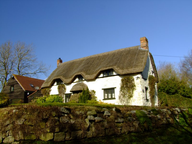 White  cottage , front  view.