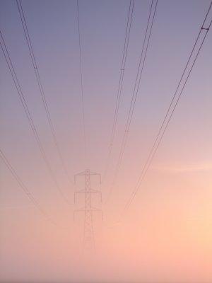 Electricity  pylon  through  the  morning  mist.
