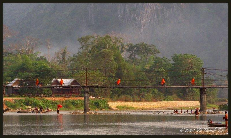 Monks crossing bridge