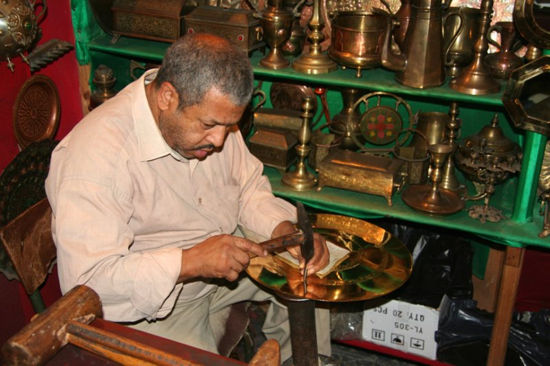 He also took me to a shop where this man was making decorative bronze plates.
