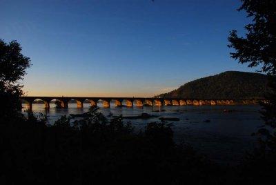 Sunrise Catches the Arches of the Rockville Bridge