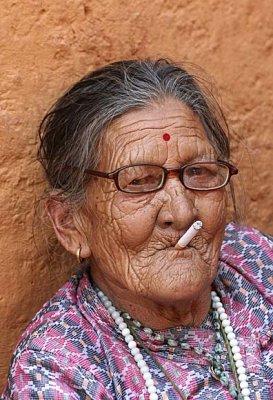 Lady smoking a cigarette, Nepal.