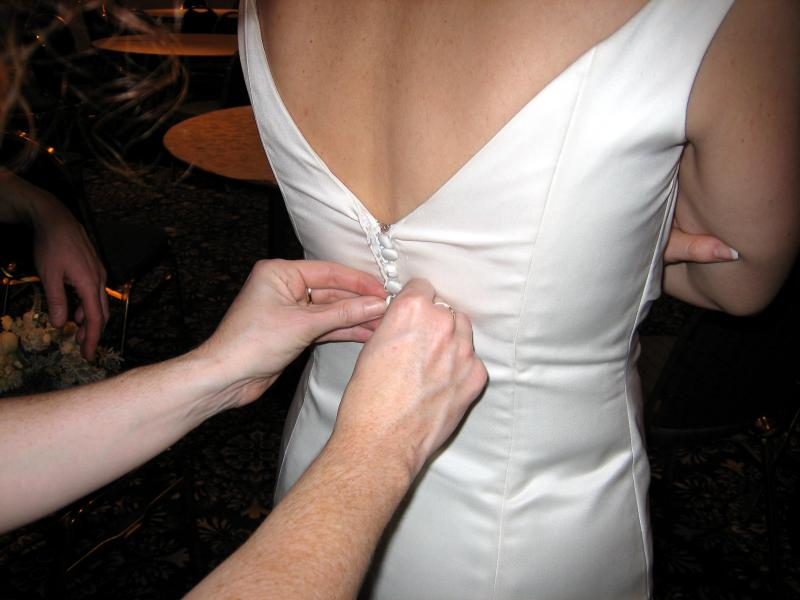 Peg gives Eric a head start on the dress