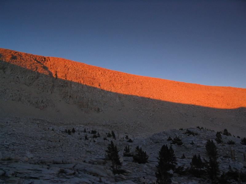 Sunset color bands on ridges above lake near southern edge of Sequoia National Park