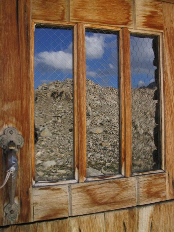 Reflections of the Sierra on the Shelters door window