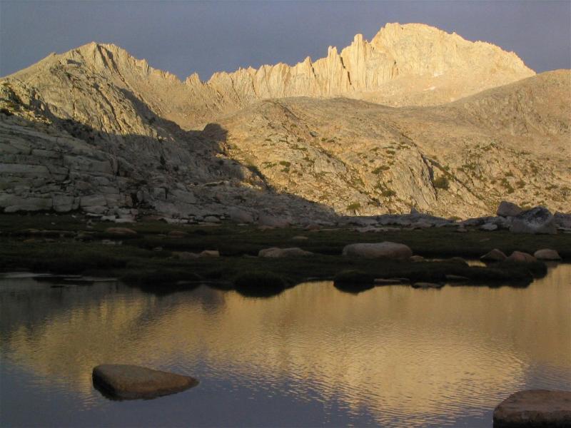 Feather Peak reflected on a tarn in Bear Basin