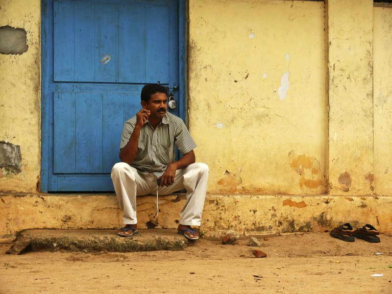 Man against blue door Trivandrum.jpg