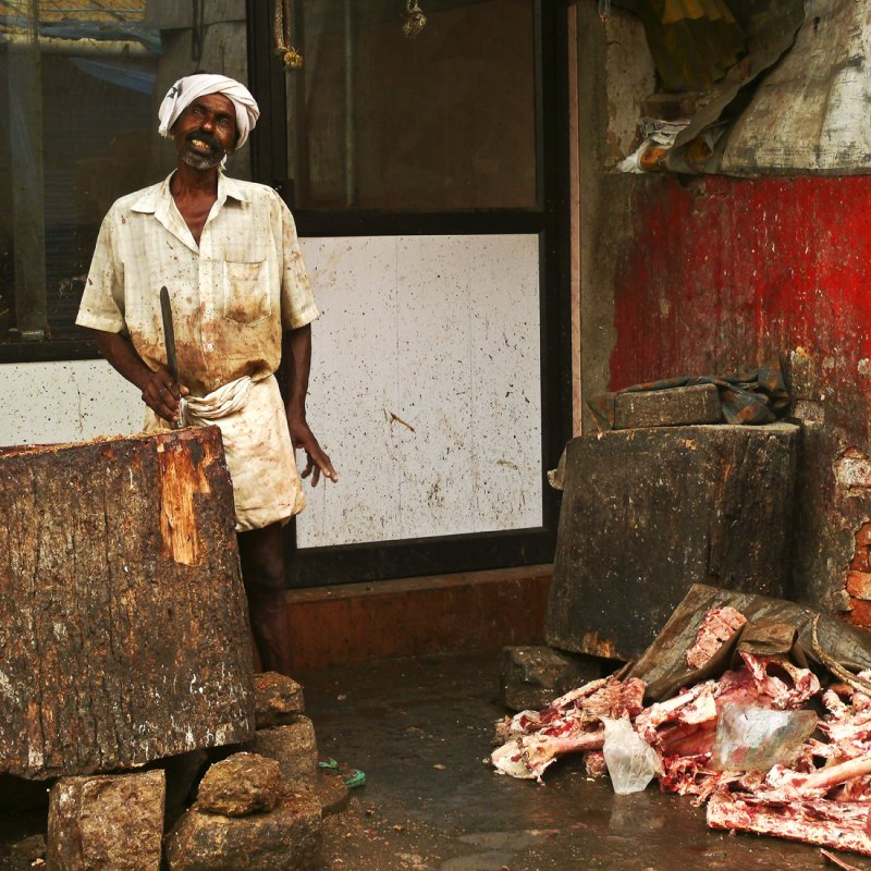 Butcher at the market of Trivandrum.jpg