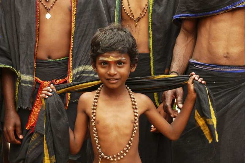 Boy pilgrim against stomachs.jpg