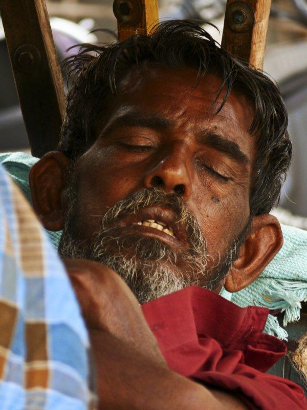 Sleeping rickshaw driver.jpg