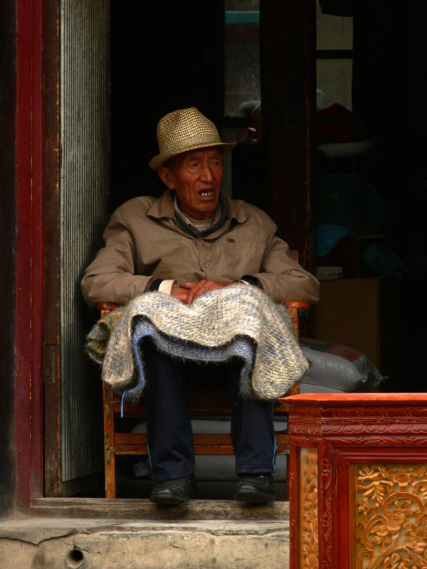 Old man in shop