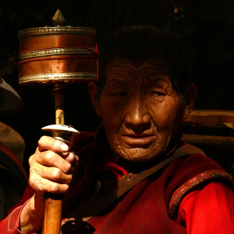 Holding prayer wheel