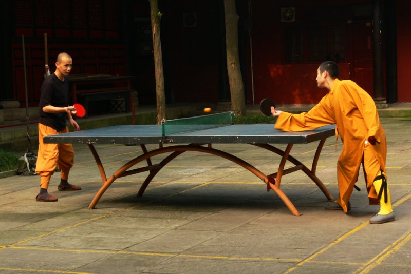 Playing a game of table tennis in Wenshu Monastery