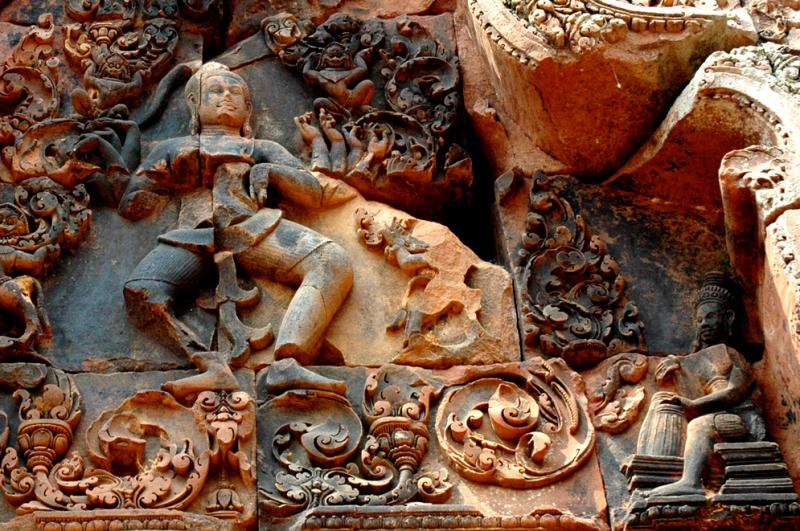 Shiva Nataraj - the god, multi-armed, in the dance of the rhythm of life.  At his feet is a drummer.
