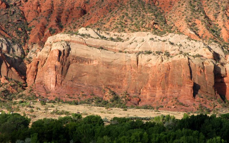 Huge cliff dwarfs a house