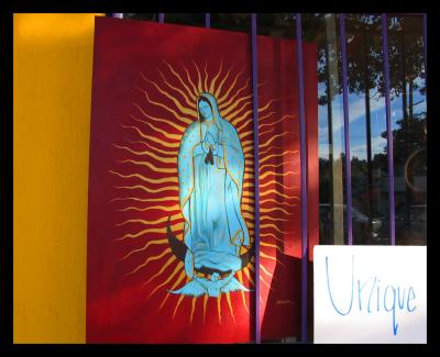 Virgin painting in the Cactus Gallery Window